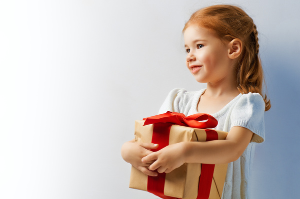 beauty childl with christmas gift